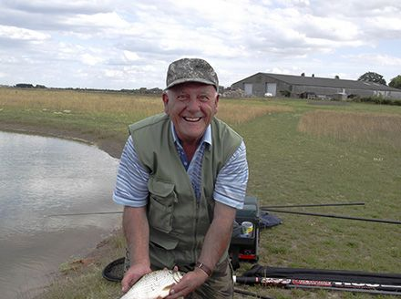 Fisherman with his catch at Elms Farm Lakes